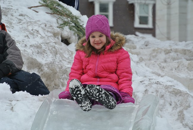 Never too old to go down the ice slide. CREDIT: Laura Meggs - Downtown Kingston!