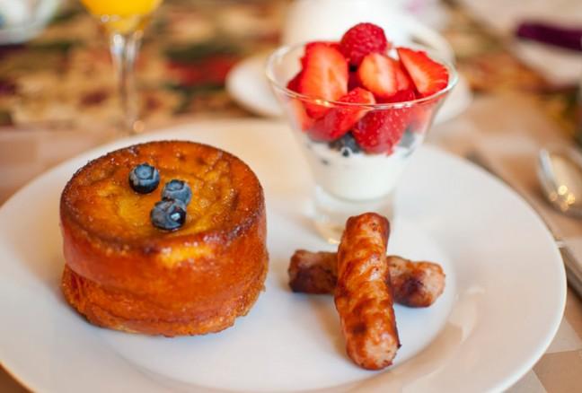 Breakfast at the Secret Garden Inn - a peach pancake, lightly herbed sausage and fresh strawberries and yogurt.