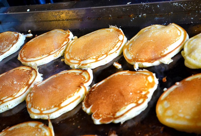 Pancakes sizzle, as they are ready to be served.