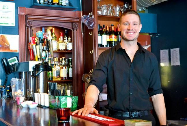 Man behind the bar - Tim Archibald.