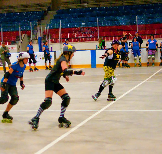 """""""Manic Breeze"""" chases """"Nikki Heat"""" to win points in a Roller Derby practice."""