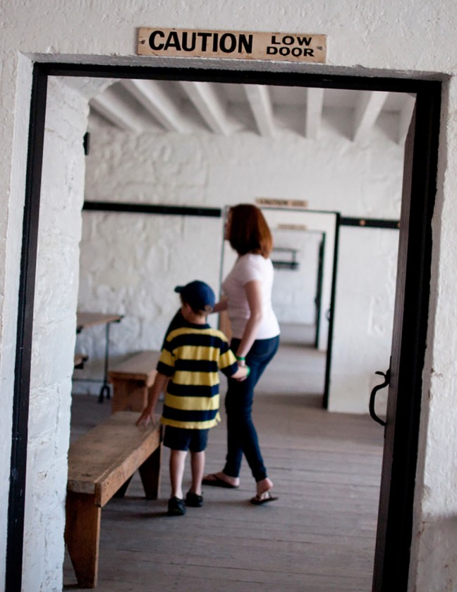 6 year-old Will and mom, Jacklyn, explore the family quarters and school house in Fort Henry.