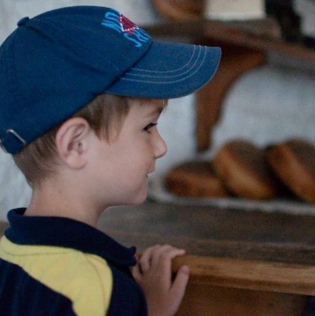 6 year-old Will salivates over the freshly-baked bread in Fort Henry's original bakery.