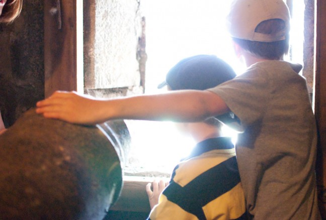 Will and Tom peering out the windows of the reverse battery at Fort Henry.