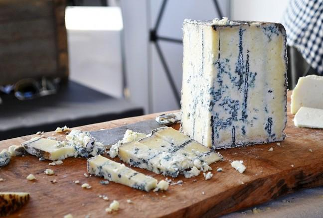 Ontario's Back Forty Artisan Cheese's Highland Blue - Semi-firm, unpressed blue mold cheese with natural rind.