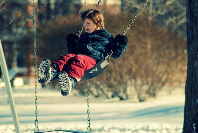 Kids can't resist swings, even in the chilly air!