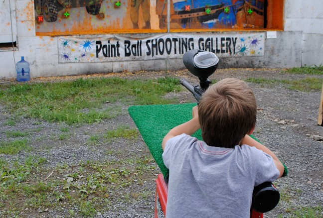 Iain taking aim at the paint ball shooting gallery