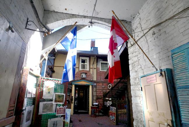 A Quebecois flag flies next to the Canadian one, recalling its inspiration from rue du Trésor inQuebec City.