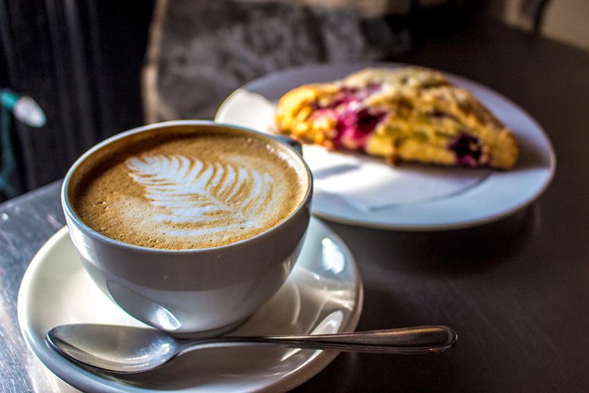 The Common Market latte and raspberry scone